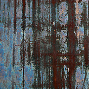 Abstract patterns of rust on background metal surface of building