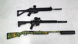 September 5, 2017 - USA - Firearms with silencers lie on the floor at a gun range at the NRA headquarters, in Fairfax, Va., on March 20, 2017. (Credit Image: © Ali Rizvi/TNS via ZUMA Wire)