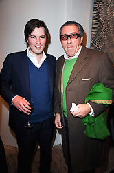 Left to right, HARRY LOPES and BROOSK SAIB at the opening of Luke Irwin's showroom at 22 Pimlico Road, London SW1 on 24th November 2010.