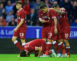 WIGAN, ENGLAND - Friday, July 14, 2017: Liverpool's Mohamed Salah prays as he celebrates scoring the first goal against Wigan Athletic during a preseason friendly match at the DW Stadium. (Pic by David Rawcliffe/Propaganda)