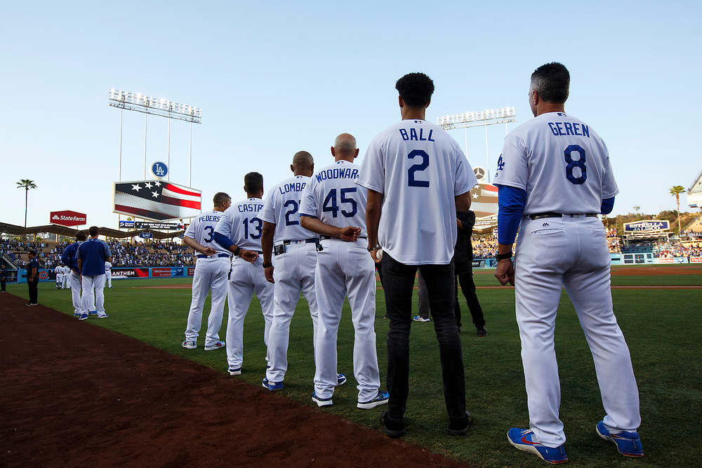 Lakers draft pick Lonzo Ball stand for the national anthem before throwing out the first pitch at Dodger Stadium on Friday, June 23, 2017 in El Segundo, California. The Lakers selected Lonzo Ball as the No. 2 overall NBA draft pick and is the son of LaVar Ball. © 2017 Patrick T. Fallon