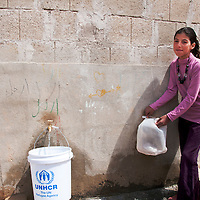 Jordan. Za'atri Camp for Syrian Refugees. Qamar collecting water.