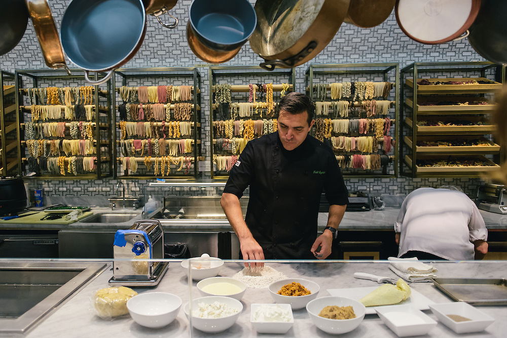 Chef Todd English preparing raviolis at Todd English Food Hall at the Plaza Hotel in New York City