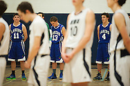 The teams listen to the National Anthem during the first round of the boys high school basketball playoffs between the Colchester Lakers and the Mount Mansfield Cougars at MMU High School on Tuesday night February 16, 2016 in Jericho. (BRIAN JENKINS/for the FREE PRESS)