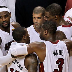 Jun 21, 2012; Miami, FL, USA; Miami Heat small forward LeBron James (6), point guard Mario Chalmers (15), shooting guard Dwyane Wade (3), power forward Chris Bosh (1) and small forward Shane Battier (31) huddle together in the fourth quarter of the 2012 NBA Finals against the Oklahoma City Thunder at the American Airlines Arena. Miami won 121-106. Mandatory Credit: Derick E. Hingle-US PRESSWIRE