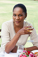 Smiling Woman Enjoying a Glass of White Wine