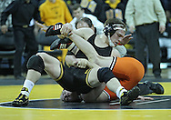 January 07, 2011: Iowa's Ethen Lofthouse tries to turn on Oklahoma State's Chris Perry during the 174-pound bout in the NCAA wrestling dual between the Oklahoma State Cowboys and the Iowa Hawkeyes at Carver-Hawkeye Arena in Iowa City, Iowa on Saturday, January 7, 2012. Perry won 3-2.