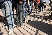 29 MARCH 2004 -- DOUGLAS, AZ: Undocumented immigrants apprehended by the US Border Patrol near Douglas, AZ, are returned to Aqua Prieta, Mexico, through the voluntary return gate on the border between Douglas and Aqua Prieta. PHOTO BY JACK KURTZ