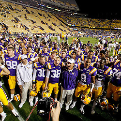 October 16, 2010; Baton Rouge, LA, USA; LSU Tigers head coach Les Miles leads his team celebrate following a win over the McNeese State Cowboys at Tiger Stadium. LSU defeated McNeese State 32-10. Mandatory Credit: Derick E. Hingle