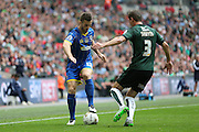 AFC Wimbledon defender Jon Meades (12) takes on Plymouth Argyle's Gary Sawyer during the Sky Bet League 2 play off final match between AFC Wimbledon and Plymouth Argyle at Wembley Stadium, London, England on 30 May 2016.