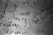 Graffitis in an abandoned house along the path to the Death Pass. Many migrants during the last 70 years used this road to escape from Italy, Jews and partisan during the fascism, north Africans and East europans during the 80s and 90s and now migrants from Afhganistan, Syria and Africa. Federico Scoppa