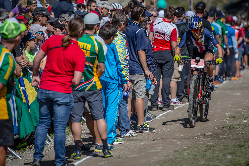 Kate Courtney (USA) in the feed zone during the Cross Country Olympics event at the 2018 UCI MTB World Championships - Lenzerheide, Switzerland