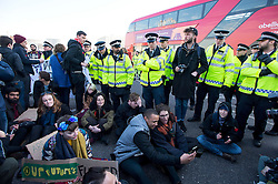 © Licensed to London News Pictures. 19/01/2016. London, UK. Police attempt to move students as they block Westminster Bridge next to the houses of parliament to protest against cuts to education.  A motion to be put forward by Labour on Tuesday afternoon will call on the government to reverse its decision to remove the last non-repayable grants to help with students' living costs. Photo credit: Ben Cawthra/LNP