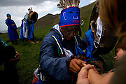 Autistic child Rowan, 5, attend a shaman ritual in Mongolia, accompanied by his parents Rupert and Kristin, their Mongolian guide Tulga, his six-year-old son Bodibilguunson and an American documentary TV crew. .Rowan's parents believe horses and shamans can unlock their son's autistic mind. This is their journey of discovery across Mongolia on horseback. .The story is published by the Sunday Times and accompany text by Tim Rayment.