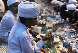 Image ©Licensed to i-Images Picture Agency. 29/06/2014. Kuala Lumpur, Malaysia. A Young Malaysian Muslim holds a date as his waits to break his fast on the first day of the holy fasting month of Ramadan. Picture by Mohd FIrdaus / i-Images
