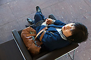 sitting Japanese woman looking up