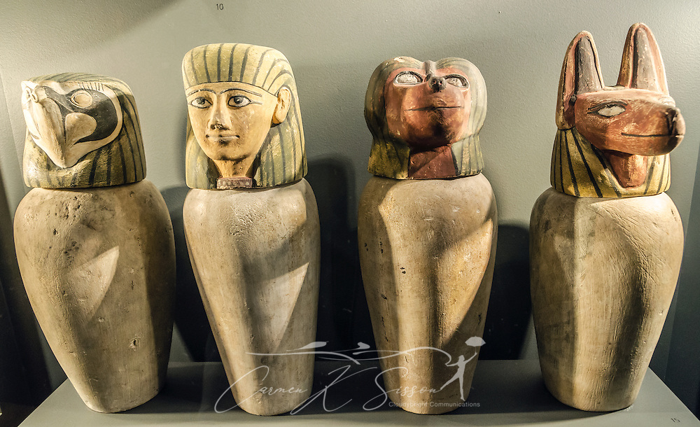 """Four """"dummy"""" Canopic jars, made of limestone, are displayed at the Michael C. Carlos Museum at Emory University, July 8, 2014, in Atlanta, Georgia. The jars were used to store the internal organs of the deceased. The Michael C. Carlos Museum was founded in 1876 and contains more than 17,000 artifacts in its permanent collections. (Photo by Carmen K. Sisson/Cloudybright)"""