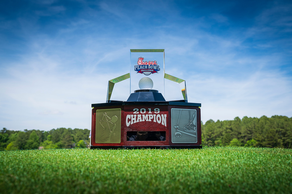 A photo of the 2019 Chick-fil-A Peach Bowl Challenge trophy at the 18th hole at the Ritz Carlton Reynolds, Lake Oconee, on Tuesday, April 30, 2019, in Greensboro, GA. (Paul Abell via Abell Images for Chick-fil-A Peach Bowl Challenge)