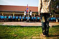 Drug abusers stand attention during the raising of the Cambodian flag, at Orkas Khnom, or My Chance, a government-run facility where youth and young men are brought here by their families or by arrest from police to be re-educated from drug addiction, just outside Phnom Penh, Cambodia, on Tuesday, May 11, 2010. The center's officials say that addicts must overcome their addiction by strengthening their will and mind. Officials say that they must re-explain how important society is; to stay away from bad people; to get a job; to know how important life is. Before they use drugs, life was normal. However a Human Rights Watch released a controversial report in January 2010 on abuses of detainees held at the 11 drug detention centers. The report said that individuals are not being treated for drug use, but rather illegally detained and often abused. ..