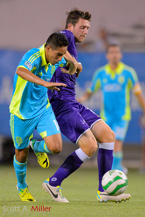Orlando City Lions midfielder Luke Boden (14) and Seattle Sounders midfielder David Estrada (16) fight for a ball during a USL Pro soccer game at the Citrus Bowl on Aug. 11, 2013 in Orlando, Florida. <br /> <br /> &copy;2013 Scott A. Miller