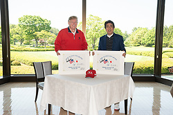 May 26, 2019 - Chiba, Chiba, Japan - U.S. President Donald Trump, left, and Japanese Prime Minister Shinzo Abe, right, pose with golf flags they signed at Mobara Country Club May 26, 2019 in Chiba, Japan. (Credit Image: © Shealah Craighead via ZUMA Wire)