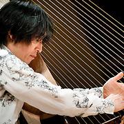 "February 18, 2012 - New York, NY : .Fuyuhiko Sasaki performs Sukeyasu Shiba's 'Winds from Ikaruga' (1991) on the kugo, an angular harp, during ""Resonances of the Kugo,"" part of the 2012 New York Music From Japan Festival, at Merkin Concert Hall on Saturday. .CREDIT: Karsten Moran for The New York Times"