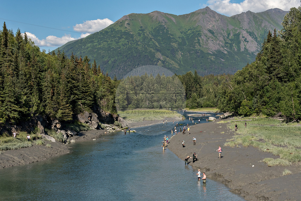 Fishermen catching silver salmon on Bird Creek in Kongiganak, outside Anchorage, Alaska.
