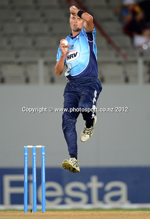 Chris Martin bowling during the HRV Cup Twenty20 Cricket match between Auckland Aces and Canterbury Wizards at Eden Park on Friday 21 December 2012. Photo: Andrew Cornaga/Photosport.co.nz