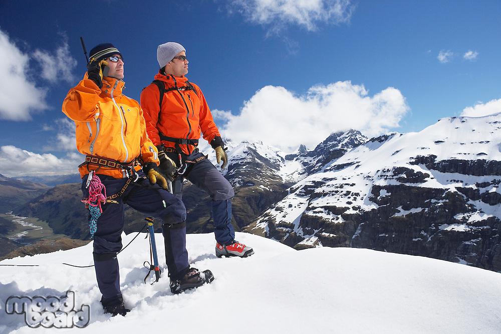 Two mountain climbers on snowy peak
