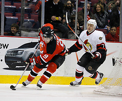 Apr 3, 2007; East Rutherford, NJ, USA; New Jersey Devils left wing Zach Parise (9) moves past Ottawa Senators defenseman Joe Corvo (7) during the first period at Continental Airlines Arena in East Rutherford, NJ.