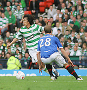 Celtic's Shunsuke Nakamura evades Rangers' Steven Whittaker during the League Cup final between Rangers and Celtic at Hampden Park -<br /> David Young Universal News And Sport