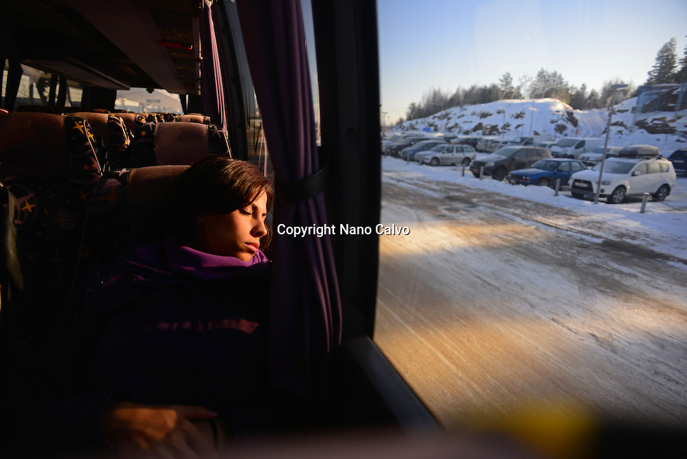 Young woman travelling by bus to Pyhä ski resort, Lapland, Finland