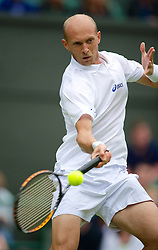 LONDON, ENGLAND - Tuesday, June 26, 2012: Nikolay Davydenko (RUS) during the Gentlemen's Singles 1st Round match on day two of the Wimbledon Lawn Tennis Championships at the All England Lawn Tennis and Croquet Club. (Pic by David Rawcliffe/Propaganda)