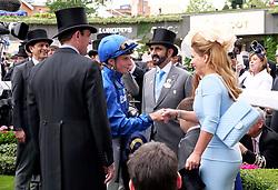 Sheikh Mohammed bin Rashid Al Maktoum with wife Princess Haya of Jordan and jockey William Buick during day one of Royal Ascot at Ascot Racecourse.