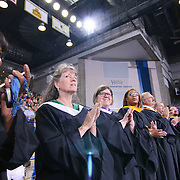 Thomas McKean High School faculty members participate in a graduation processional during McKean 49th commencement exercises Saturday, June 06, 2015, at The Bob Carpenter Sports Convocation Center in Newark, Delaware.
