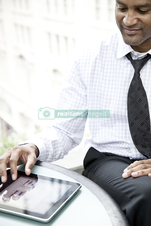 June 17, 2010 - A black businessman working on a notebook computer. (Credit Image: © Mint Images via ZUMA Wire)