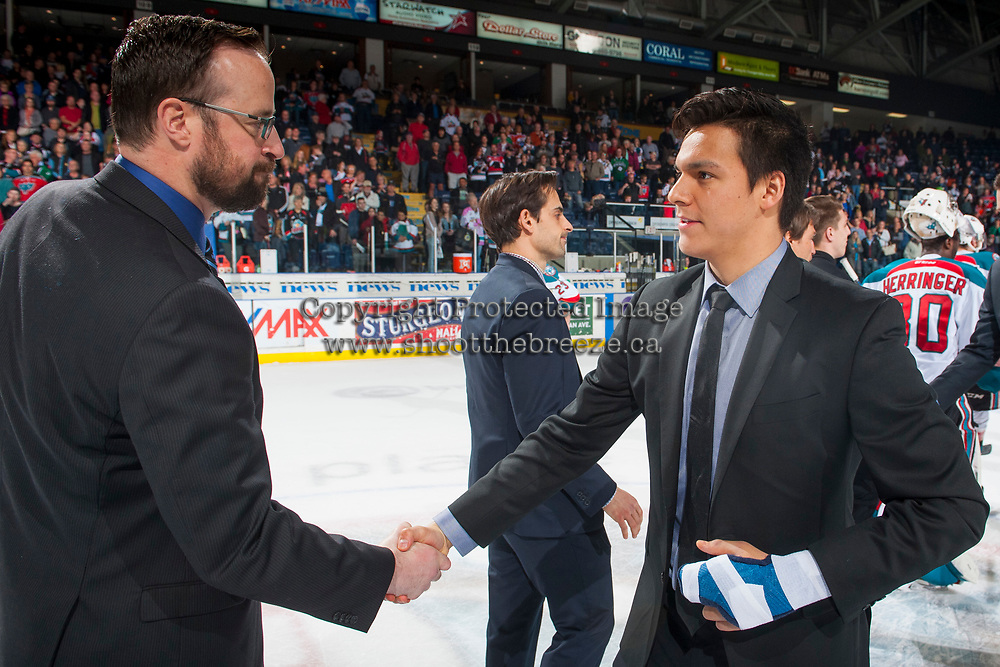 KELOWNA, CANADA - APRIL 30: Kelowna Rockets' assistant coach Kris Mallette shakes hands with Ethan Bear #25 of the Seattle Thunderbirds on April 30, 2017 at Prospera Place in Kelowna, British Columbia, Canada.  (Photo by Marissa Baecker/Shoot the Breeze)  *** Local Caption ***