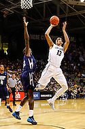 November 16th, 2013:  Colorado Buffaloes freshman forward Dustin Thomas (13) attempts a shot in the first half of the NCAA Basketball game between the Jackson State Tigers and the University of Colorado Buffaloes at the Coors Events Center in Boulder, Colorado