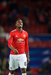 MANCHESTER, ENGLAND - Tuesday, March 13, 2018: Manchester United's Paul Pogba walks off the pitch dejected as his side crash out of Europe losing 1-2 to Sevilla during the UEFA Champions League Round of 16 2nd leg match between Manchester United FC and Sevilla FC at Old Trafford. (Pic by David Rawcliffe/Propaganda)