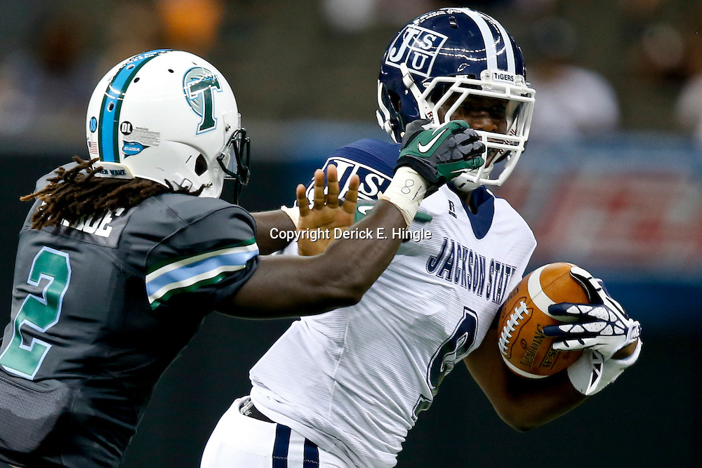 Aug 29, 2013; New Orleans, LA, USA; Jackson State Tigers quarterback LaMontiez Ivy (9) run from Tulane Green Wave safety Darion Moore (2) during the first half of a game at the Mercedes-Benz Superdome. Mandatory Credit: Derick E. Hingle-USA TODAY Sports