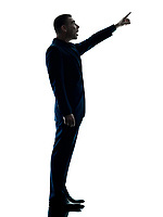 one caucasian business man standing pointing silhouette isolated on white background
