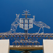 "The Australian Coat of Arms atop Parliament House, Canberra. The emblem features a kangaroo and an emu and a shield. Parliament House is the meeting place of the Parliament of Australia. It is located in Canberra, the capital of Australia. It was opened on 9 May 1988 by Queen Elizabeth II, Queen of Australia.[1] Its construction cost was over $1.1 billion. At the time of its construction it was the most expensive building in the Southern Hemisphere. Prior to 1988, the Parliament of Australia met in the Provisional Parliament House, which is now known as ""Old Parliament House""."