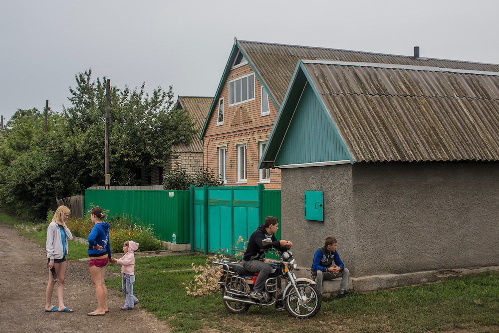 GRABOVO, UKRAINE - JULY 18: Local residents watch the scene of an Air Malaysia plane crash on July 18, 2014 in Grabovo, Ukraine. Malaysia Airlines flight MH17 travelling from Amsterdam to Kuala Lumpur has crashed on the Ukraine/Russia border near the town of Shaktersk. The Boeing 777 was carrying 280 passengers and 15 crew members. (Photo by Brendan Hoffman/Getty Images) *** Local Caption ***
