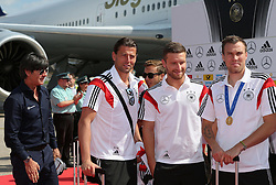 15.07.2014, Flughafen Tegel, Berlin, GER, FIFA WM, Empfang der Weltmeister in Deutschland, Finale, im Bild vl. Bundestrainer Joachim Loew (GER), Roman Weidenfeller (GER), Shkodran Mustafi (GER) und Kevin Grosskreutz (GER) // during Celebration of Team Germany for Champion of the FIFA Worldcup Brazil 2014 at the Flughafen Tegel in Berlin, Germany on 2014/07/15. EXPA Pictures © 2014, PhotoCredit: EXPA/ Eibner-Pressefoto/ Eibner Pressefoto / pool<br /> <br /> *****ATTENTION - OUT of GER*****
