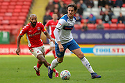 Rochdale defender Jordan Williams (8) taking on Charlton Athletic midfielder Josh Parker (10) during the EFL Sky Bet League 1 match between Charlton Athletic and Rochdale at The Valley, London, England on 4 May 2019.