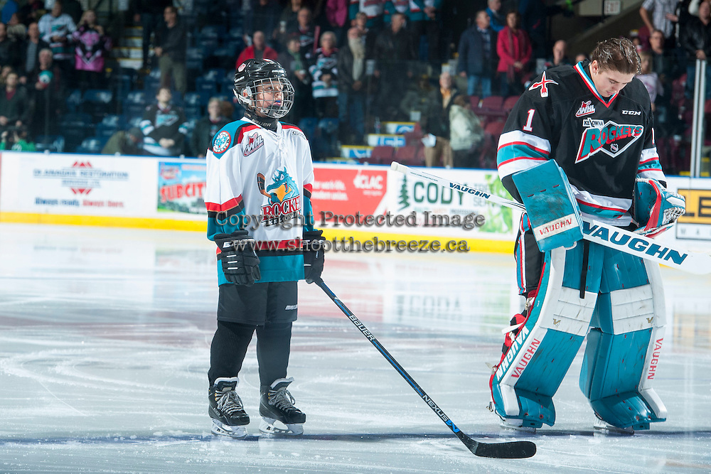 KELOWNA, CANADA - DECEMBER 2: The Pepsi Save On Foods player of the game lines up with Jackson Whistle #1 of the Kelowna Rockets against the Kootenay Ice on December 2, 2015 at Prospera Place in Kelowna, British Columbia, Canada.  (Photo by Marissa Baecker/Shoot the Breeze)  *** Local Caption *** Pepsi Save On Foods player; Jackson Whistle;