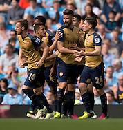 Olivier Giroud of Arsenal (3rd right) celebrates with team-mates after scoring his team's equalising goal during the Barclays Premier League match at the Etihad Stadium, Manchester<br /> Picture by Russell Hart/Focus Images Ltd 07791 688 420<br /> 08/05/2016