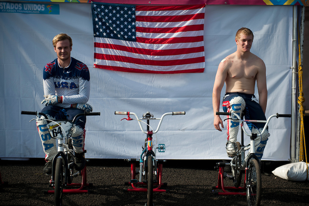 Oct. 21, 2011 - Guadalajara, Mexico -  (from left) Nicholas James Long and Connor Fields from the USA on their bikes outside the USA tent before the semifinals of men's BMX on day seven of the XVI Pan American Games. In the finals, Fields received the gold medal with a time of 34.245 seconds and Long won Silver with a time of 34.907...©Benjamin B Morris