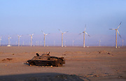 Egyptisk vindmøllesatsing i samarbeid med danskene, på vegen mellom Hurghada og Kairo. Foto: Bente Haarstad Wind turbines used in wind farms for commercial production of electric power are usually three-bladed and pointed into the wind by computer-controlled motors. Wind energy production in Egypt.