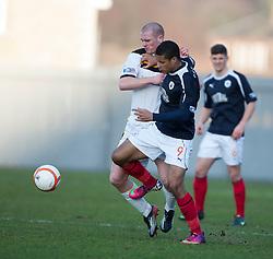 Dumbarton's Alan Lithgow and Falkirk's Lyle Taylor..Dumbarton 0 v 2 Falkirk, 23/2/2013..©Michael Schofield.